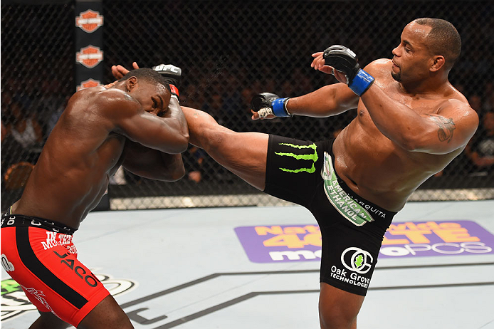 LAS VEGAS, NV - MAY 23: (R-L) Daniel Cormier kicks Anthony Johnson in their UFC light heavyweight championship bout during the UFC 187 event at the MGM Grand Garden Arena. (Photo by Josh Hedges/Zuffa LLC)