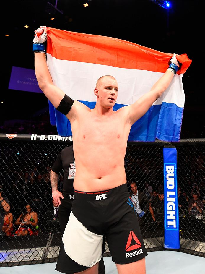 """Stefan Struve celebrates his win over <a href='../fighter/Antonio-Silva'>Antonio Silva</a> at Fight Night Rotterdam"""" align=""""right"""" /> seconds to dispatch Antonio """"Bigfoot"""" Silva in his return to action. Stepping in on short notice, Omielanczuk puts his three-fight win streak on the line. A heavy handed southpaw, has also has nine career submission victories.</p><p>Everyone talks about Struve's reach advantage, but he rarely takes advantage of it. It's just not his style. Instead of staying on the outside and throwing straight punches, he prefers to fight on the inside. While counterintuitive, his height makes it very easy for him to sneak in knees to the face. This is one of his preferred techniques, especially as a counter to charging opponents. Omielanczuk could take advantage of Struve's relative passivity, but his strikes can be looping and wide. Even if Struve doesn't batter him with 1s and 2s, the """"Skyscraper"""" is a more refined striker. Both fighters have sub 50% defense, so expect a slugfest. At the end of the day, Struve's superior technique and newfound power elevate him to a first round knockout.</p></div><div readability="""