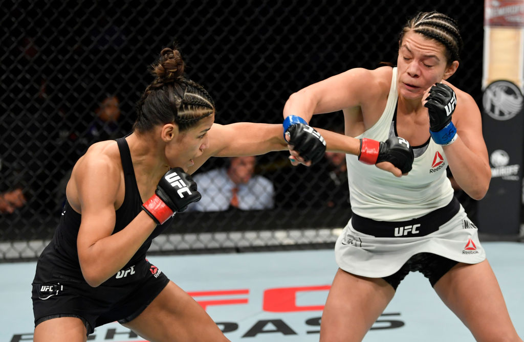 Pena punches Nicco Montano in their bantamweight bout, 2019